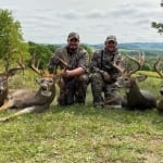 Four Hunters with harvested bucks.